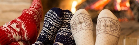 feet with socks on, by a fireplace
