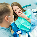 Relaxed female patient discussing sedation dentistry in Coatesville