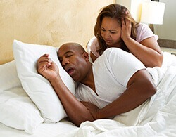 woman disturbed due to husband snoring