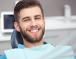 A man smiling in the dentist chair