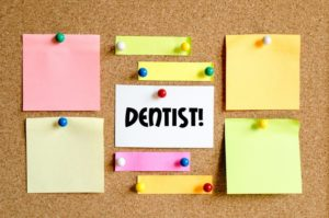 reminder on bulletin board to prevent skipping a dental cleaning